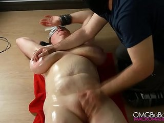 Busty slave pussy fingered by her master